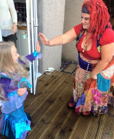 A high five for Yana the Mermaid