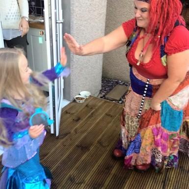 A high five for Yana the Mermaid